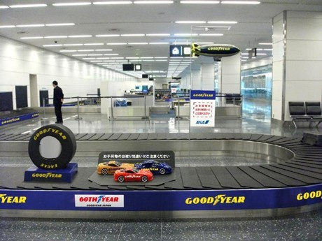 Model Race Cars on Haneda Baggage Carousels in Goodyear Japan Ad Blitz