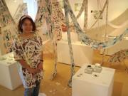 秋田のアートスペースでハッピーモチーフの手拭い展