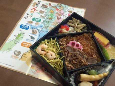 県内の観光地情報マップも同梱(どうこん)する「秋田のんめもの弁当」
