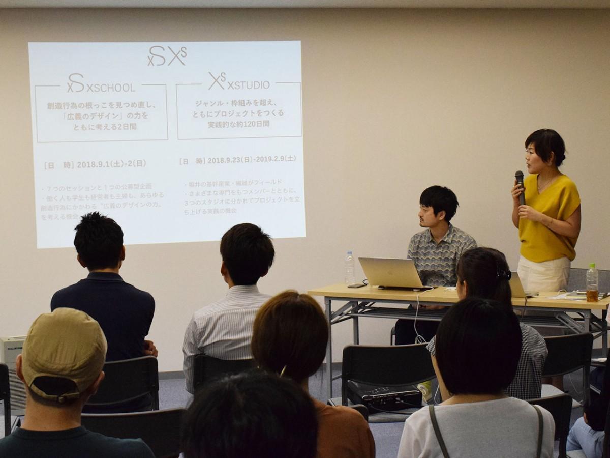事業の概要を説明する内田さん(右)