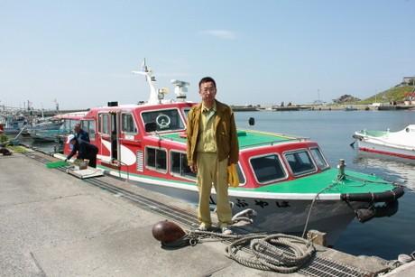 運航再開を喜ぶ遊覧船船長の岩見富光さん