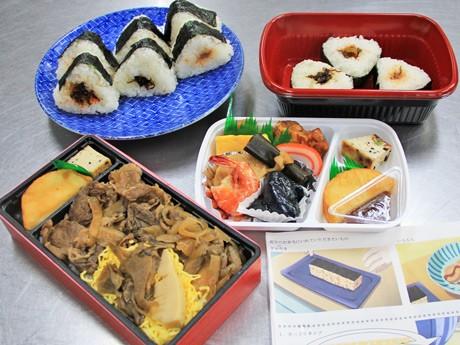 ネットで予約販売する「氷菓イベント記念弁当」(写真左上のおにぎりはイメージ)