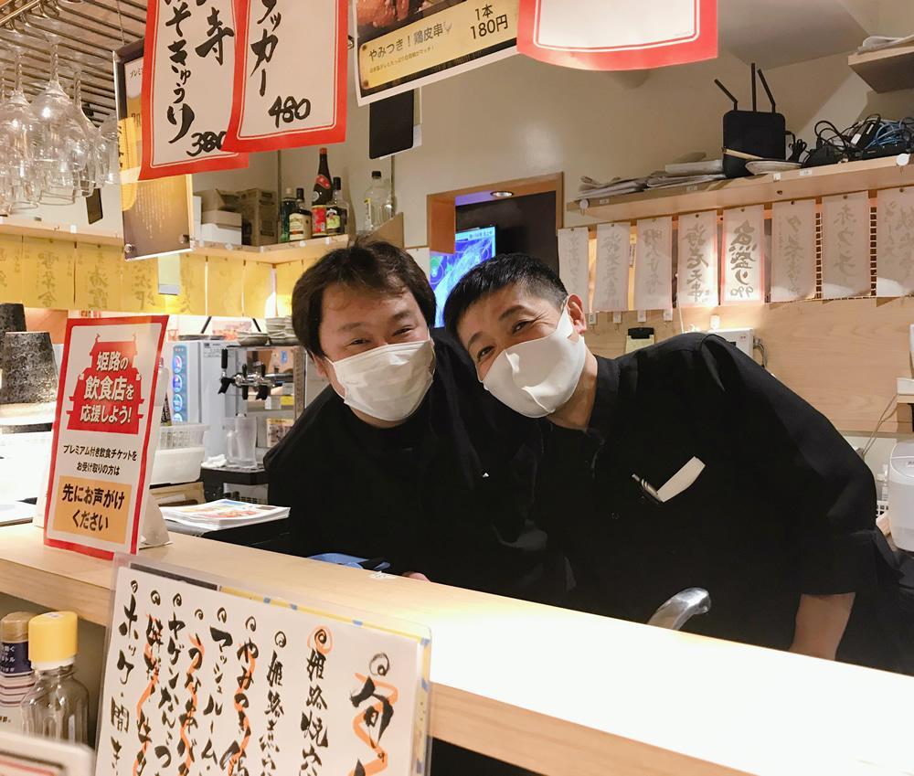 店長の吉田智裕さん(右)