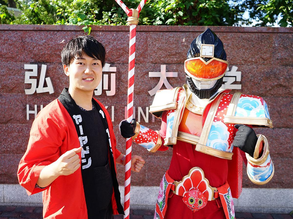 ヤーヤドン(右)と清藤慎一郎さん(左)