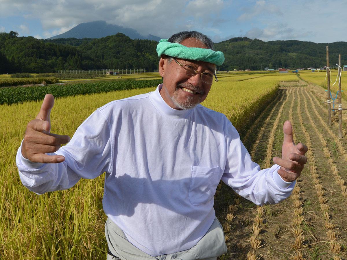 吉幾三さん。昨年9月に西目屋で穫れる幾三米の稲刈り中に撮影