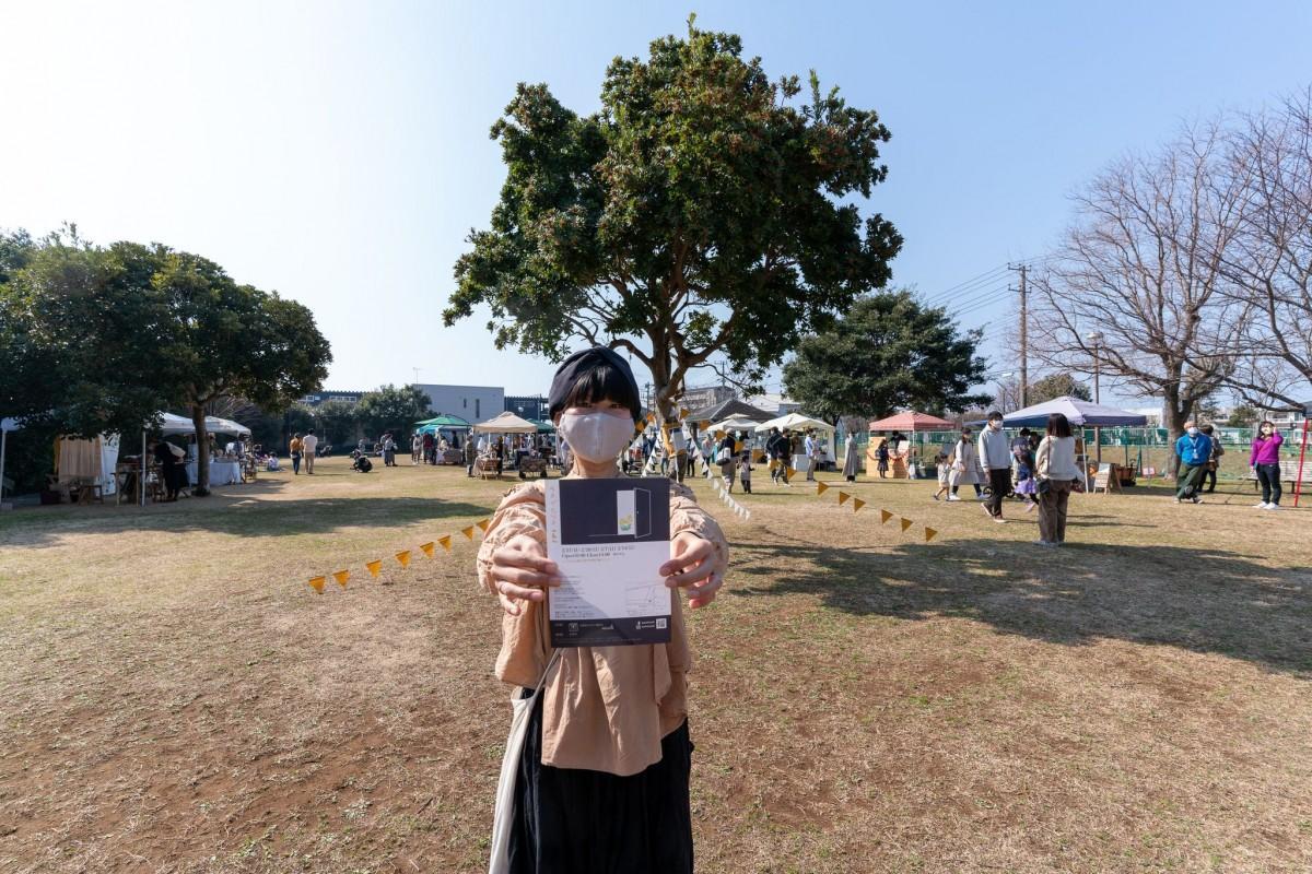 会場と主催者の中村さん