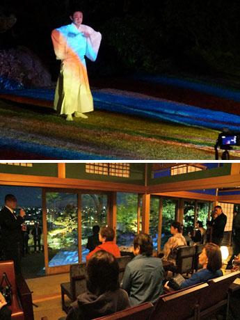 モリ川ヒロトーさんの映像で踊る藤間信乃輔さん(写真上)。映像が投影された庭を眺める参加者(写真下)