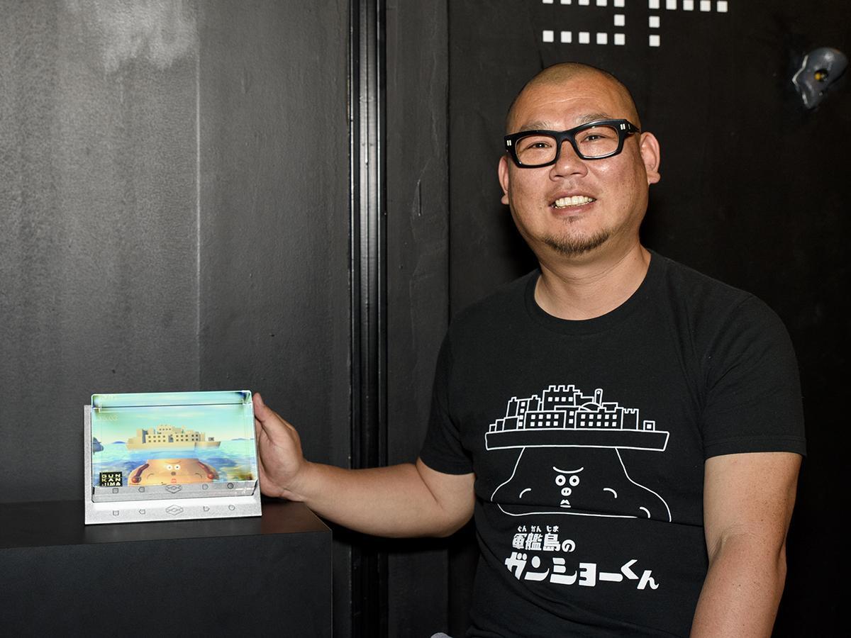 「軍艦島のガンショーくん~ちゃぷちゃぷ水槽3D~」をPRする川口さん