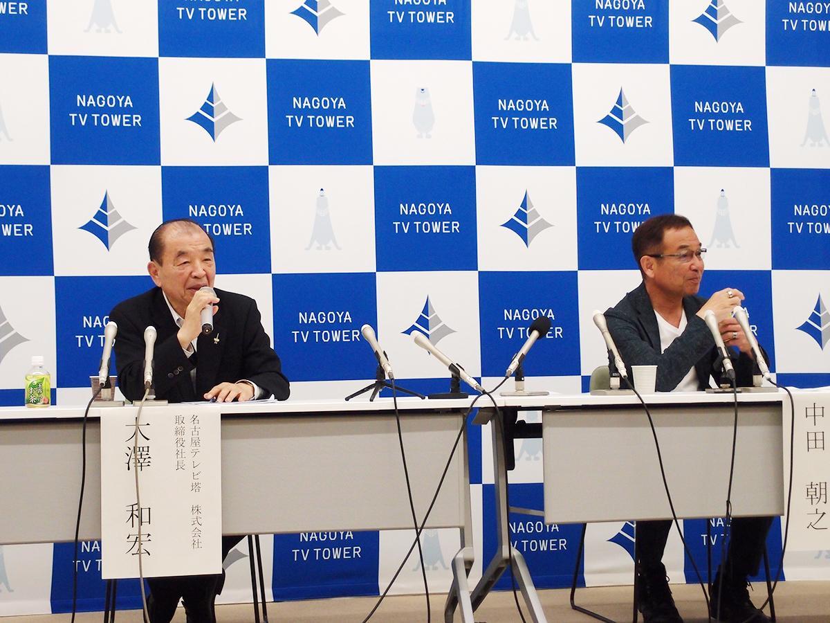 グランドオープンと内容について記者会見を行った大澤和宏社長(左)と総合プロデューサーの中田朝之さん(右)。バックボードに見えるのは新ロゴ・マークとキャラクター