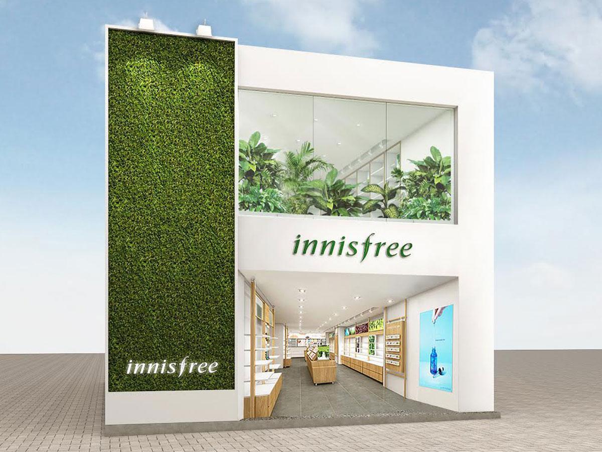 白と緑を基調にする店舗外観イメージ