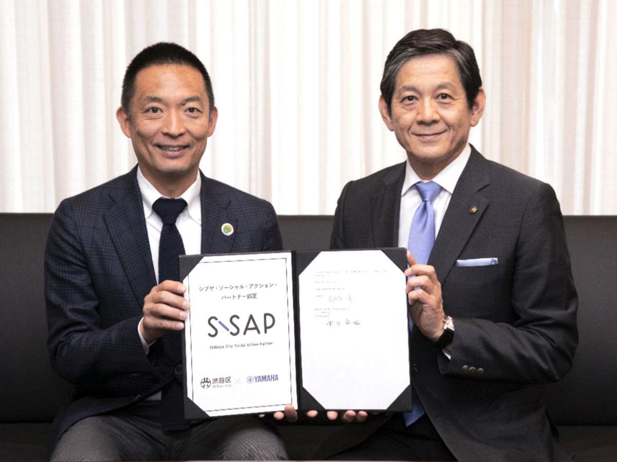 (左から)長谷部健渋谷区長とヤマハ中田卓也社長