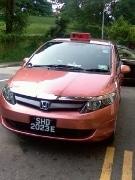 プライム・タクシー社が運行する環境にやさしいCNG方式のタクシー(写真の車種はTOYOTAのWISH)