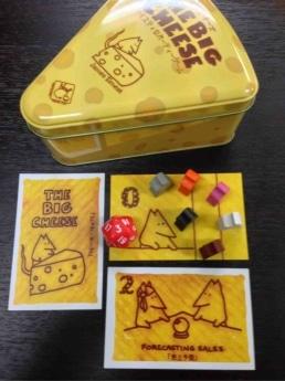 4月末発売予定の復刻ゲーム「ビッグ・チーズ」(予価3000円)。ネズミの社員を使って大きな仕事(チーズ)をゲットするオークションとダイス(サイコロ)のゲーム。