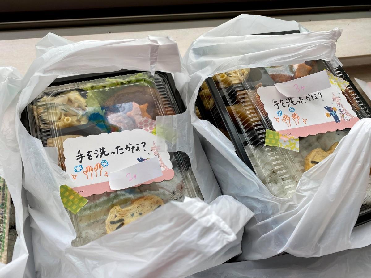 手書きメッセージ付きのお弁当を配布