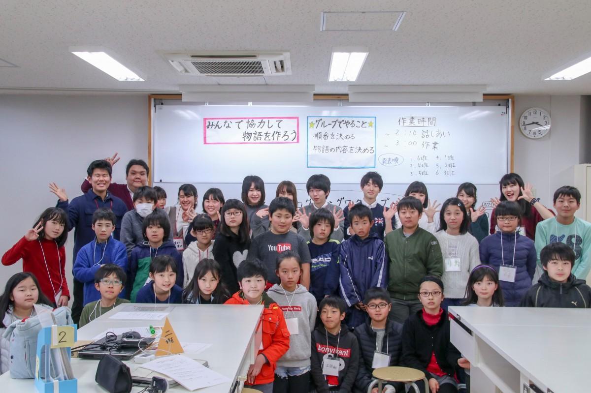 学習院大学 プログラミング教育研究サークルの学生と子どもたち