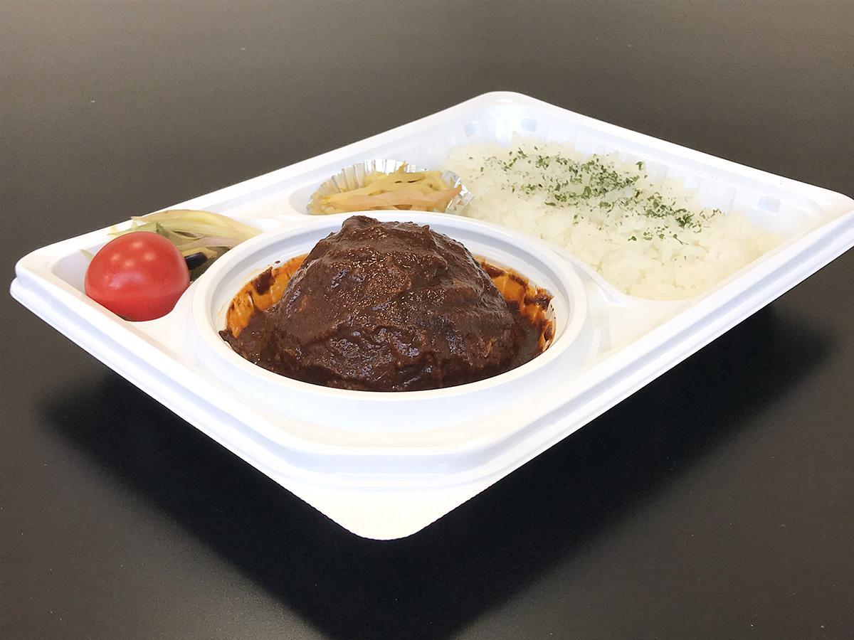 まろやかなソースで煮込まれたハンバーグがどーん「煮込みハンバーグ弁当」(600円)