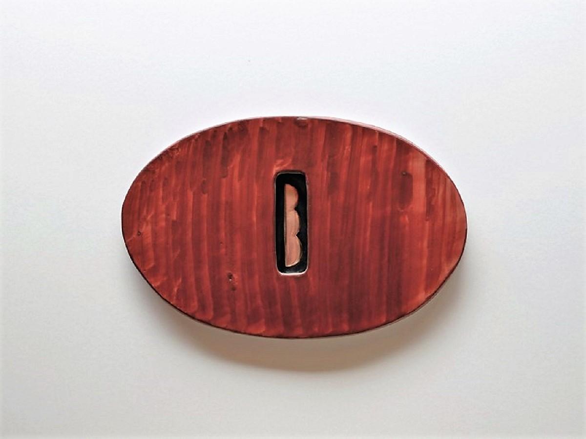林さんの銅板作品を入れた陶額