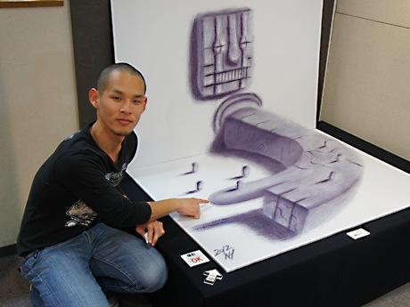 3Dアート作品「案内」と作者の永井秀幸さん