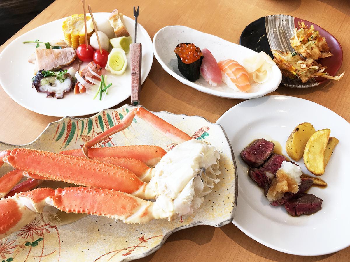 ズワイガニ、豊西牛、イクラなど北海道の食材を使った料理