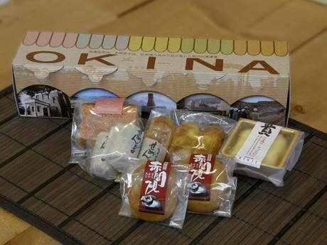 「産業観光バスツアー」催行を記念して販売する「産業観光お土産便OKINA(オキナ)」