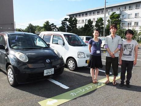 カーシェアに関する研究をする同大助教・鈴木さん(左)と小澤さん(右)、ヘビーユーザーの日隈さん