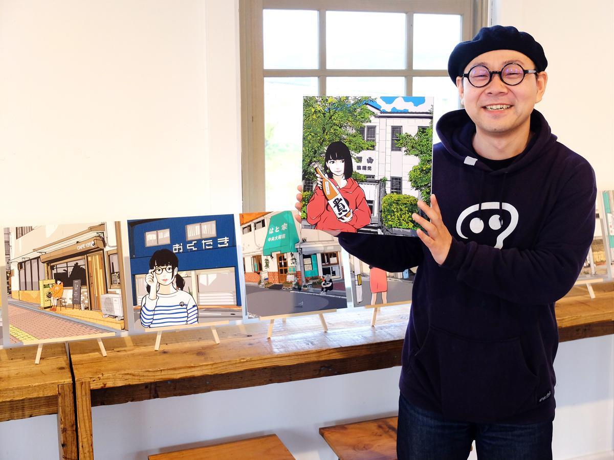 会場である「永山本家酒造場」を描いた新作を手にするkozi69さん